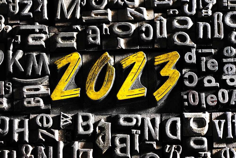 Old lead letters with golden writing show the word 2023, Germany, Europe