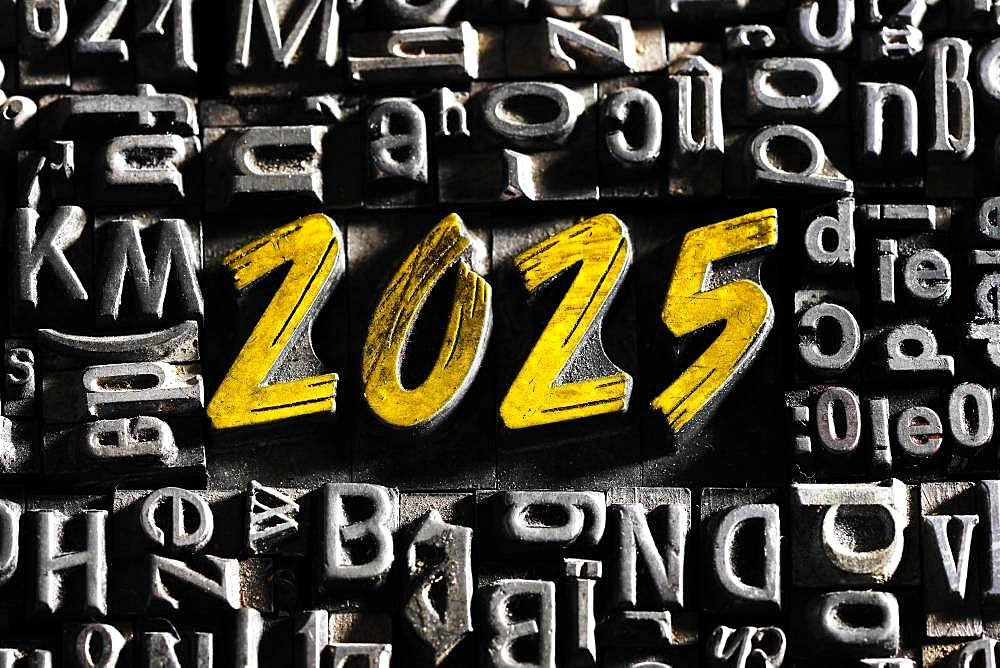Old lead letters with golden writing show the word 2025, Germany, Europe
