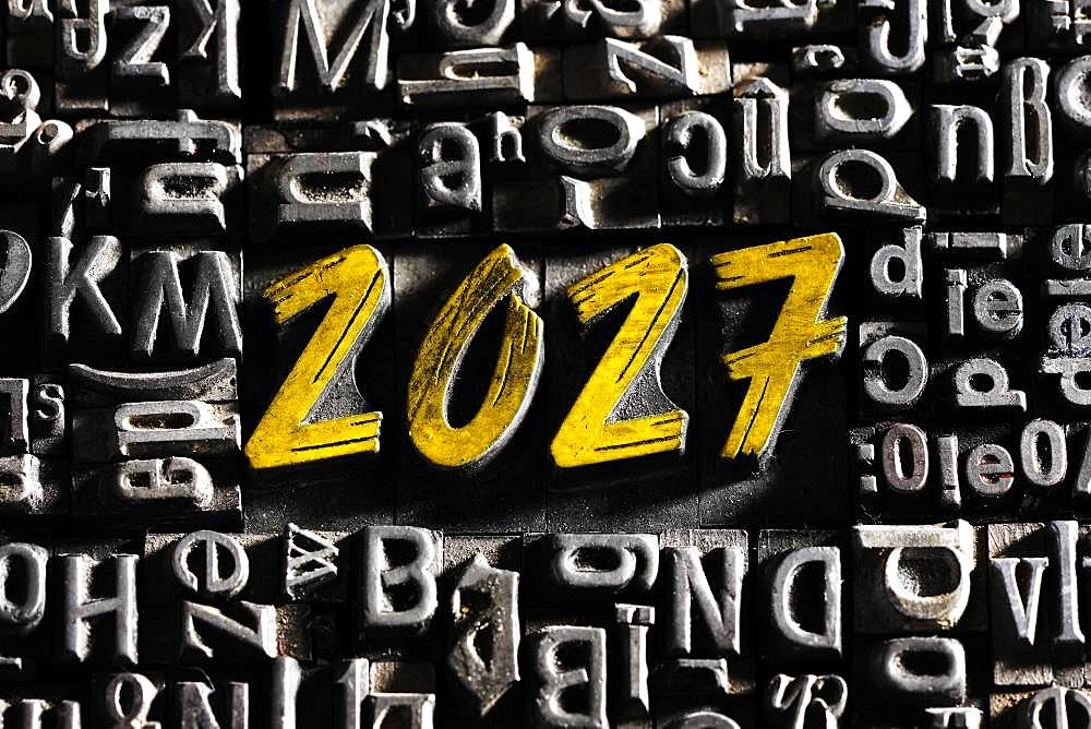 Old lead letters with golden writing show the word 2027, Germany, Europe