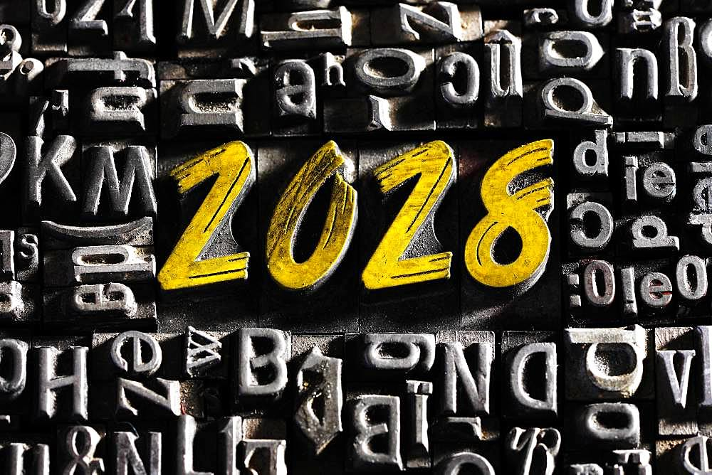 Old lead letters with golden writing show the word 2028, Germany, Europe - 832-387458