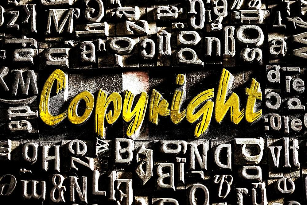 Old lead letters with golden writing show the word Copyright, Germany, Europe