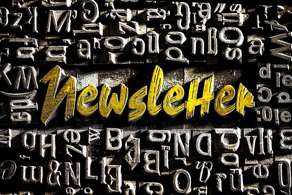 Old lead letters with golden writing show the word Newsletter, Germany, Europe