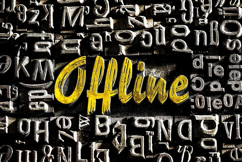Old lead letters with golden writing show the word offline, Germany, Europe