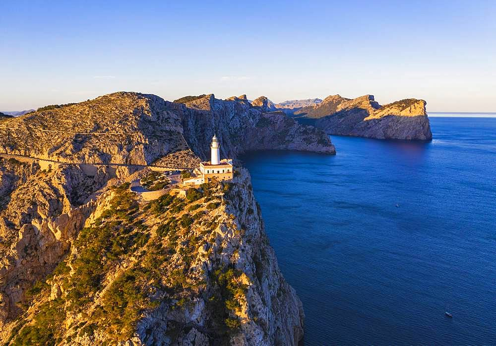 Cap Formentor with lighthouse in the morning light, Formentor peninsula, near Pollenca, aerial view, Majorca, Balearic Islands, Spain, Europe