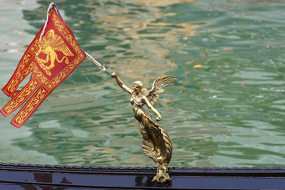 Angel figure with Venetian flag on a gondola, Venice, Veneto, Italy, Europe