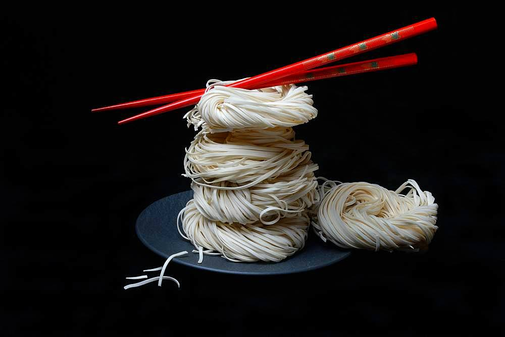Asian nest noodles with red chopsticks, Germany, Europe