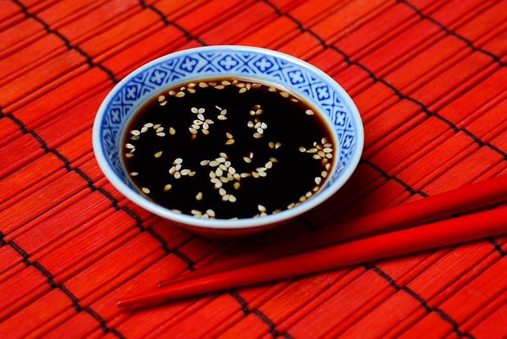 White sesame seed with soy sauce in small bowl, Germany, Europe
