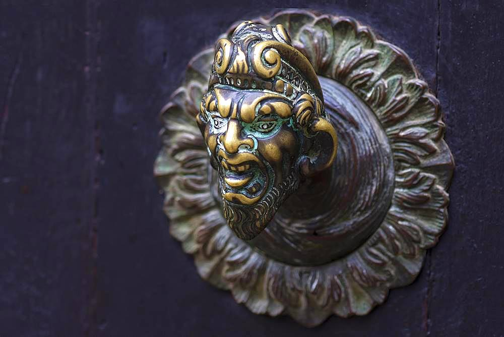 Male bronze figure as doorknob, Venice, Veneto, Italy, Europe