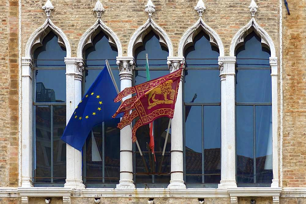 Waving flags of Europe and the Republic of Venice at Palazzo Zaguri, Venice, Venice, Italy, Europe