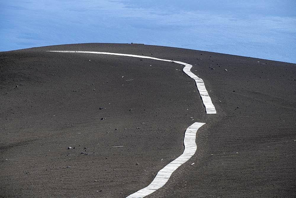 Path made of wooden planks on the Osorno volcano, Vicente Perez Rosales National Park, Region de los Lagos, Chile, South America