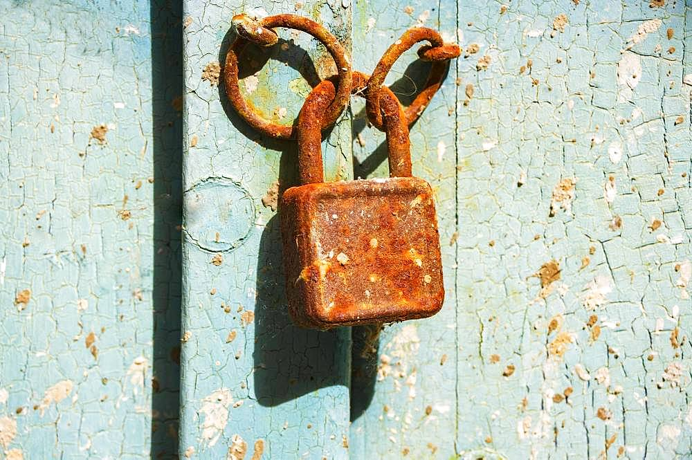 Old rusty door lock on weathered wooden door, Baska, island of Krk, Kvarner Gulf Bay, Croatia, Europe