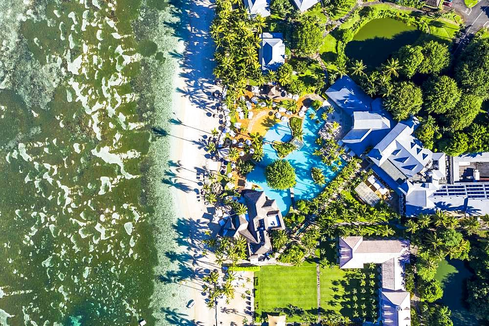 The beach of Flic en Flac with the luxury hotel Sugar Beach Golf & Spa Resort and palm trees, Mauritius, Africa