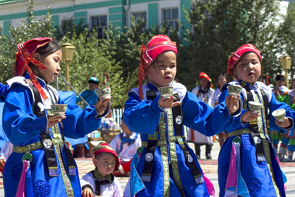 Three Mongolian children, traditionally dressed, Khovd Province, Mongolia, Asia