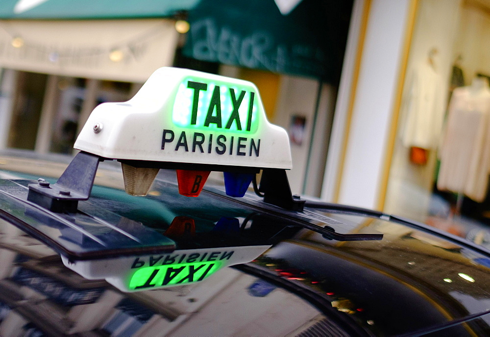 Sign of a Parisian taxi reflected in the roof, Paris, France, Europe