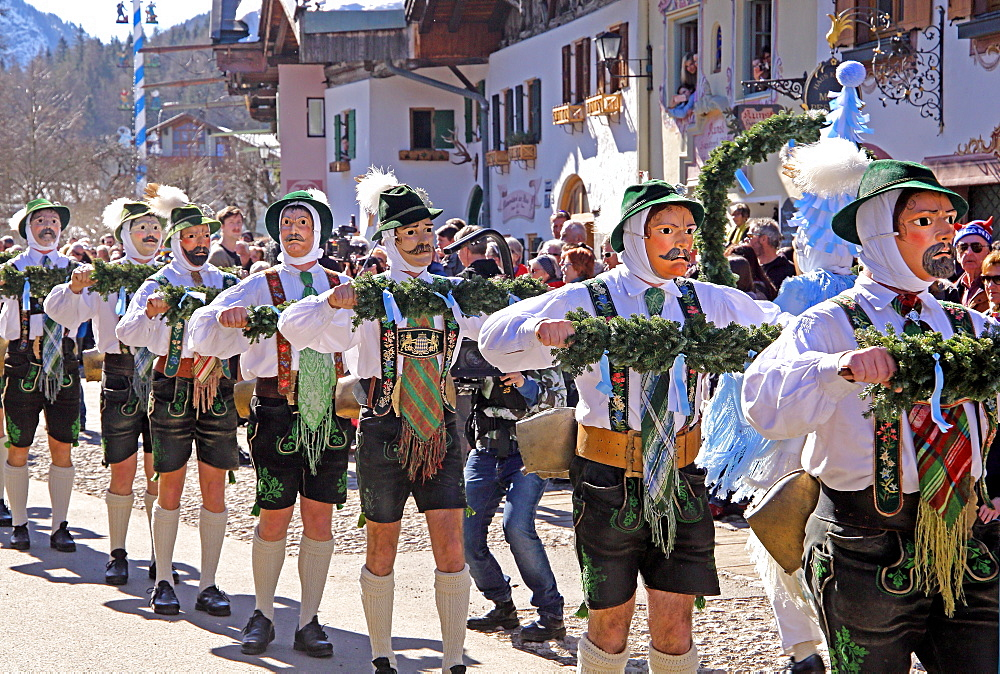 Bell stirrer in the Maschkera procession at carnival, Mittenwald, Werdenfelser Land, Upper Bavaria, Bavaria, Germany, Europe