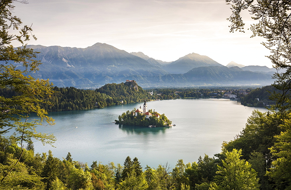 Lake Bled with the island Blejski Otok with St. Mary's Church, behind it Karawanken, Bled, Slovenia, Europe