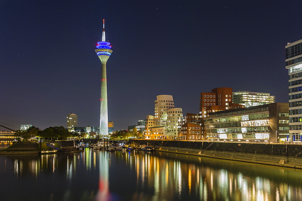 Night shot, marina in the Media Harbour, Rhine Tower, Gehry Bauten, Duesseldorf, North Rhine-Westphalia, Germany, Europe