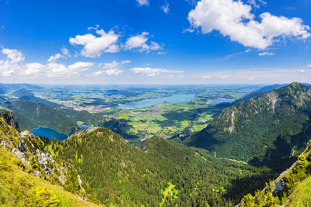 Panorama from Saeuling, 2047m, to the Tannheimer Berge, Vils, in the district Reutte in Tyrol, Austria, as well as Falkensteinkamm, Weissensee, Fuessen, Hopfensee, Forggensee and Bannwaldsee, Ostallgaeu, Bavaria, Germany, Europe