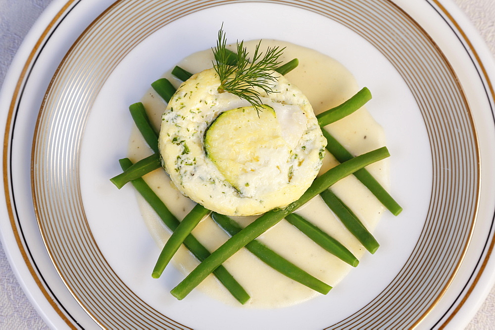 Swabian cuisine, Ofenschlupfer with pike-perch, green beans with sauce arranged on plates, dill, Germany, Europe
