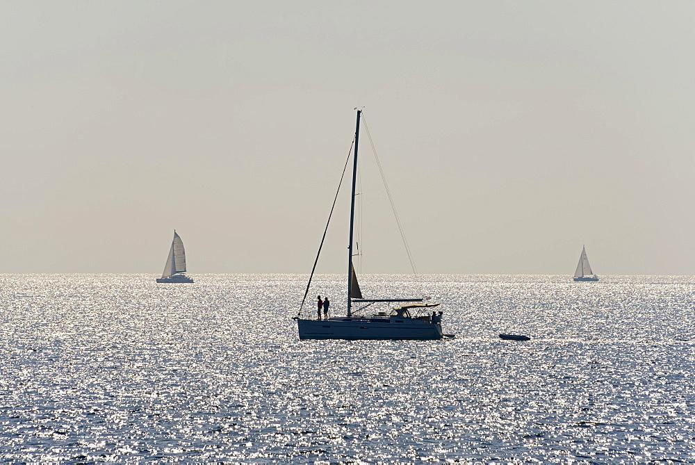Sailing ship, back light, reflections, Dalmatia, Croatia, Europe