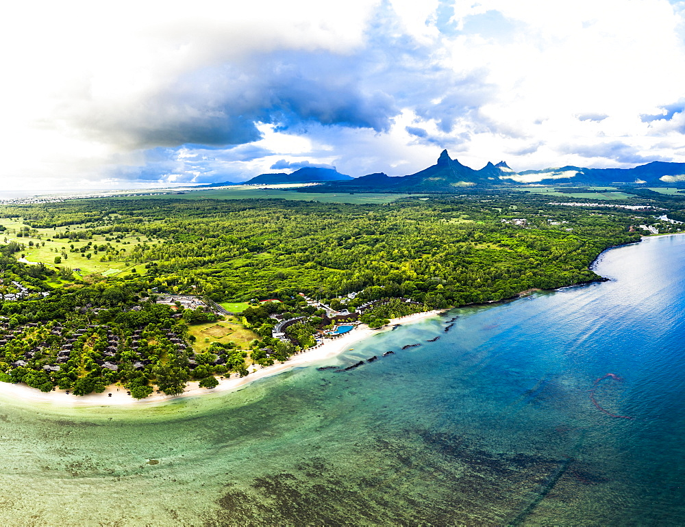 Aerial view, the beach of Flic en Flac with luxury hotels and palm trees, in the back the mountain Trois Mamelles, Mauritius, Africa