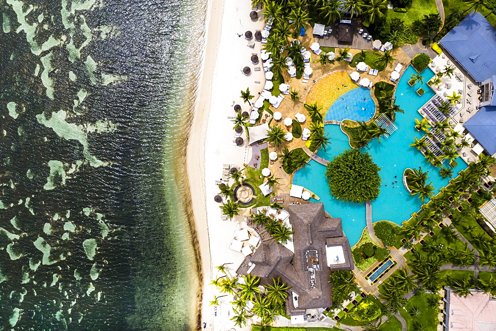 Aerial view, the beach of Flic en Flac with the luxury hotel Sugar Beach Resort & Spa and palm trees, Mauritius, Africa