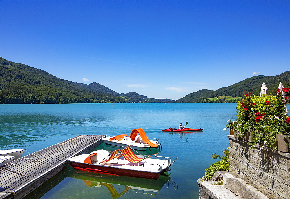 Pedal boats at the landing stage on the lake promenade, Fuschlsee, Fuschl am See, Salzkammergut, Province of Salzburg, Austria, Europe