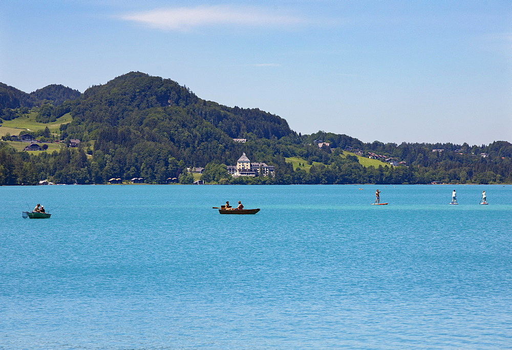 Boats at the Fuschlsee with castle Fuschl,,Fuschl am See, Salzkammergut, Country Salzburg, Austria, Europe