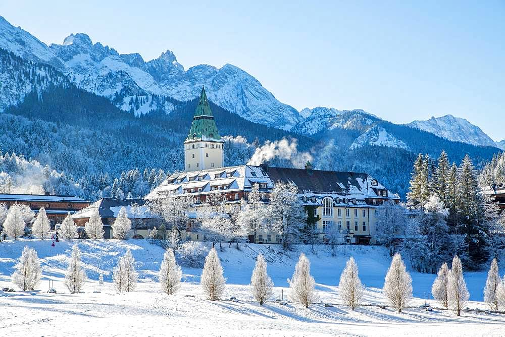 Luxury Hotel Elmau Castle in winter, behind Wetterstein range, Bavarian Oberland, Kruen, Bavaria, Germany, Europe
