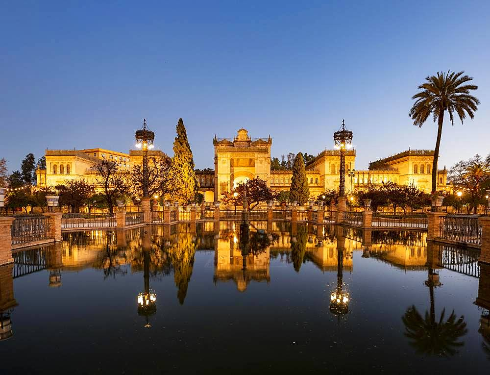 Archaeological Museum of Seville reflected in a fountain, dusk, Plaza de America, Seville, Andalusia, Spain, Europe