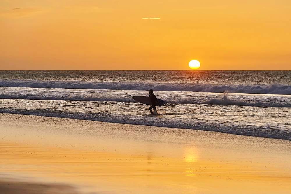 Backlit surfers, sunset beach of Playa del Castillo, Playa del Aljibe de la Cueva, Fuerteventura, Canary Islands, Spain, Europe