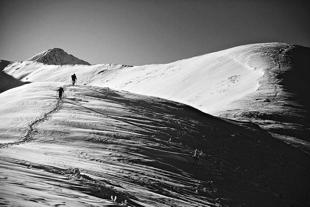 Two tourists on the approach under Rakoń peak winter road, Tatra National Park, Poland, Europe - 832-388580
