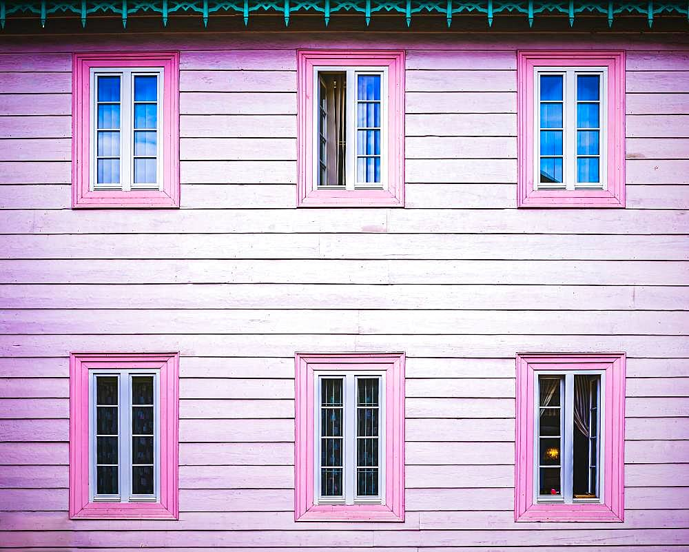 Pink wooden facade with windows, architectural detail, Poland, Europe