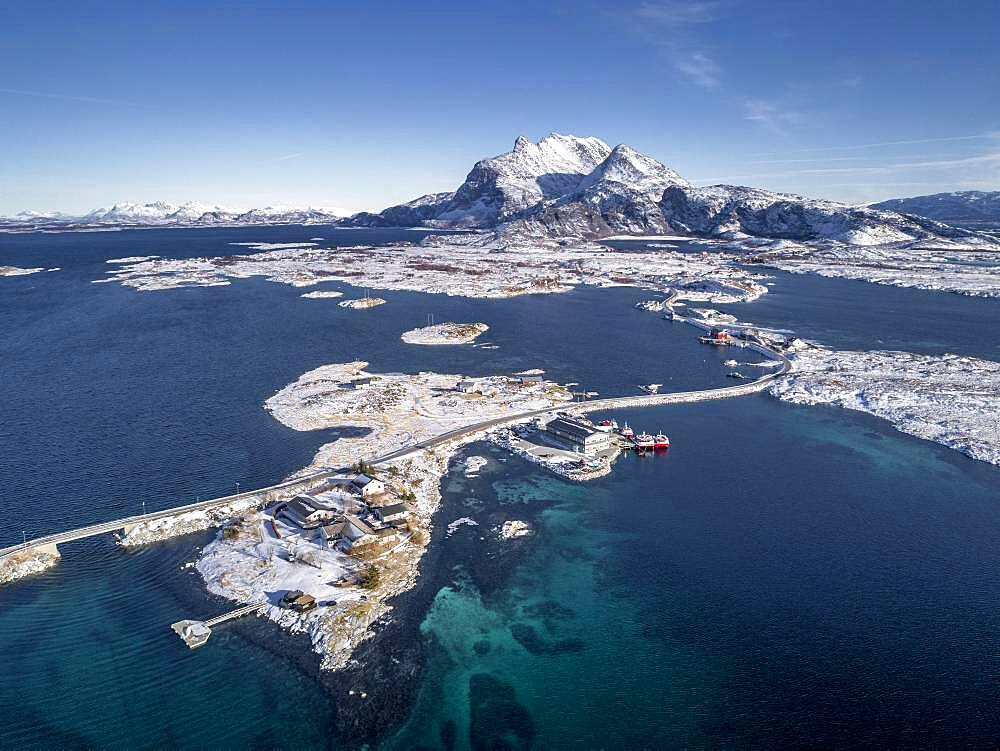 Aerial view, country road through the sea connects populated, small, winterly islands with the mainland, behind mountains, Heroy, Nordland, Norway, Europe - 832-389367