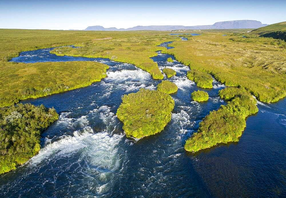 Aerial view of small green grass-covered islands in the river Laxa i Aoaldal, mountains in the background, Myvattn, Skutustaoir, Norourland eystra, Iceland, Europe - 832-389403
