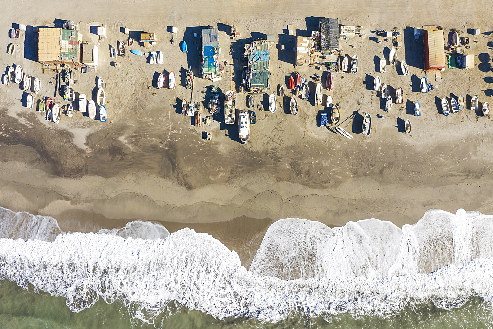 Fishing boats and fishermen cottages at the beach of San Miguel de Cabo de Gata, aerial view, drone shot, Nature Reserve Cabo de Gata-Nijar, Almeria province, Andalusia, Spain, Europe - 832-390047