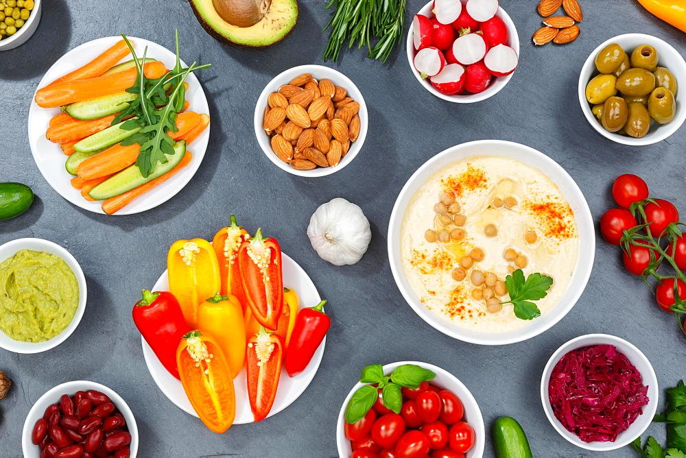 Vegetable background vegan healthy food vegan healthy organic clean eating food on slate - 832-390423