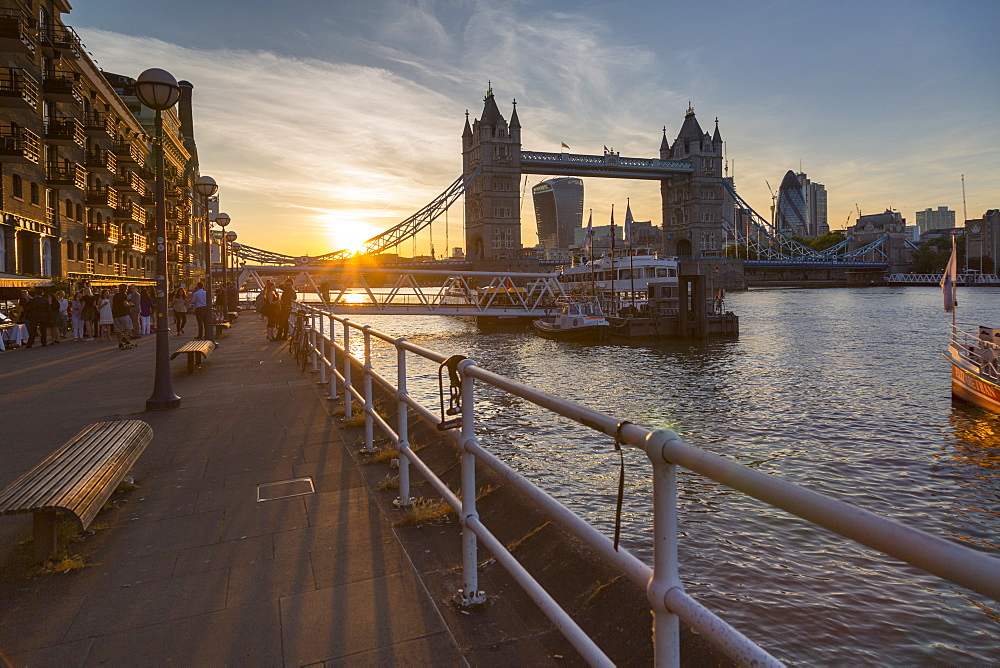 Tower Bridge and City of London skyline from Butler's Wharf at sunset, London, England, United Kingdom, Europe
