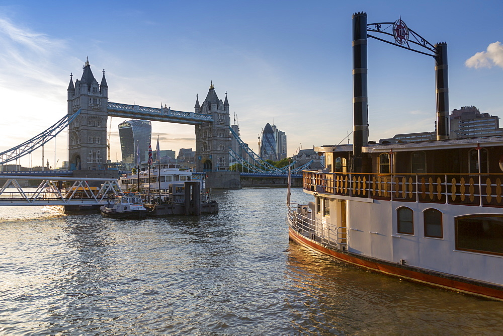 Tower Bridge, traditional riverboat and City of London skyline from Butler's Wharf, London, England, United Kingdom, Europe