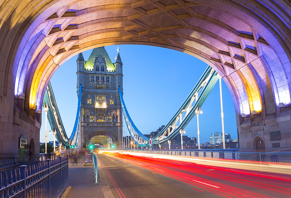 View of North Tower of Tower Bridge and car trail lights at dusk, London, England, United Kingdom, Europe