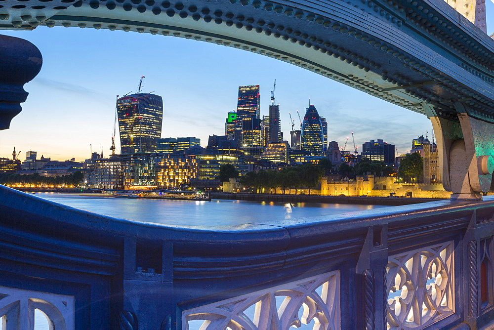 View of City of London skyline from Tower Bridge at dusk, London, England, United Kingdom, Europe