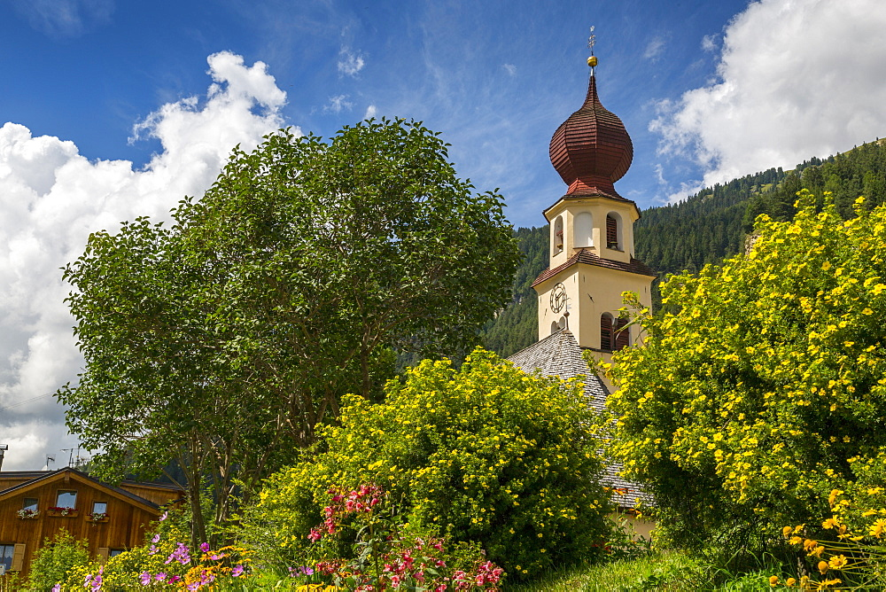 Traditional Church and houses in Canazei, South Tyrol, Italian Dolomites, Italy, Europe