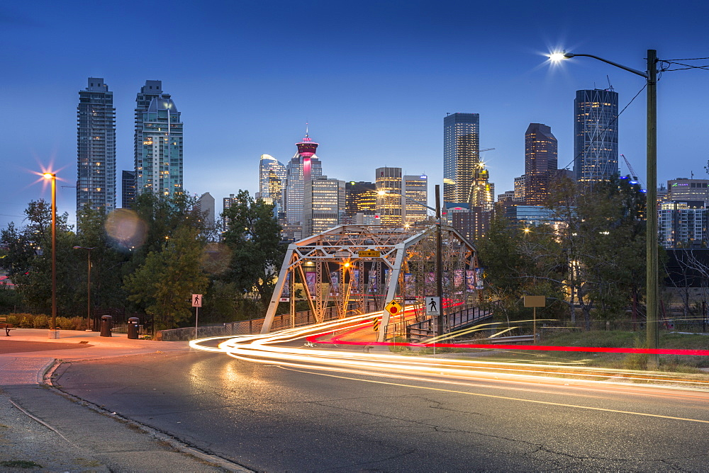 Car trail lights through Macdonal Avenue bridge and Downtown skyline at dusk, Calgary, Alberta, Canada, North America