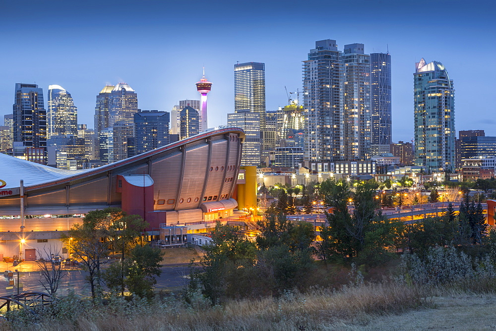 View of the Saddledome and Downtown skyline from Scottsman Hill at dusk, Calgary, Alberta, Canada, North America - 844-14378