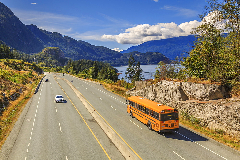 Yellow school bus on The Sea to Sky Highway near Squamish, British Columbia, Canada, North America