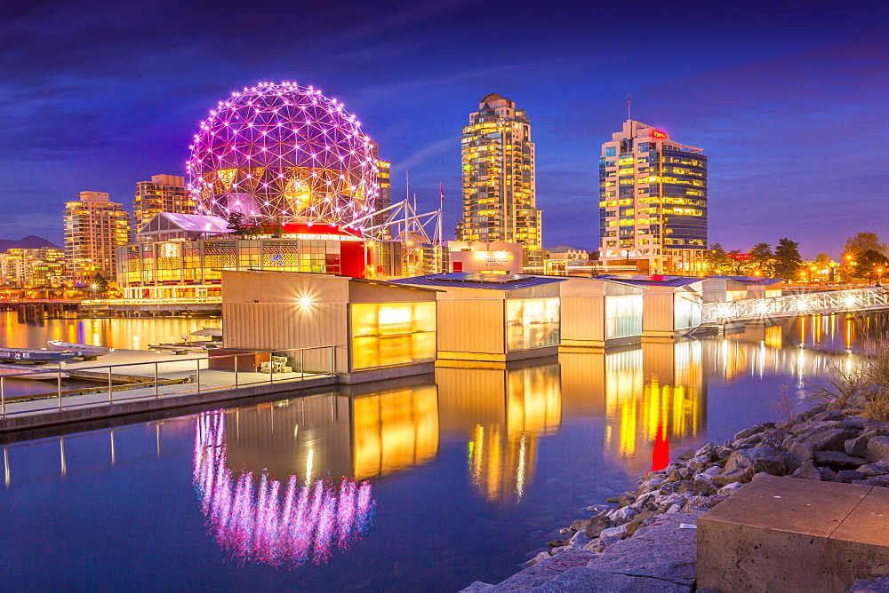 View of False Creek and Vancouver skyline, including World of Science Dome at dusk, Vancouver, British Columbia, Canada, North America
