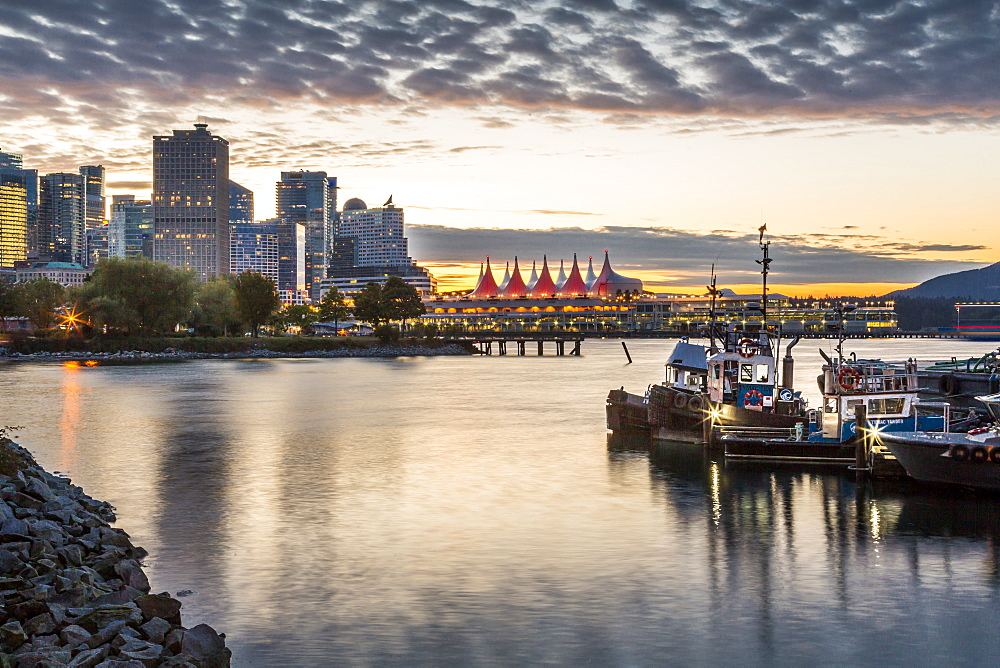 View of Canada Place and urban office buildings at sunset from CRAB Park, Vancouver, British Columbia, Canada, North America - 844-14447