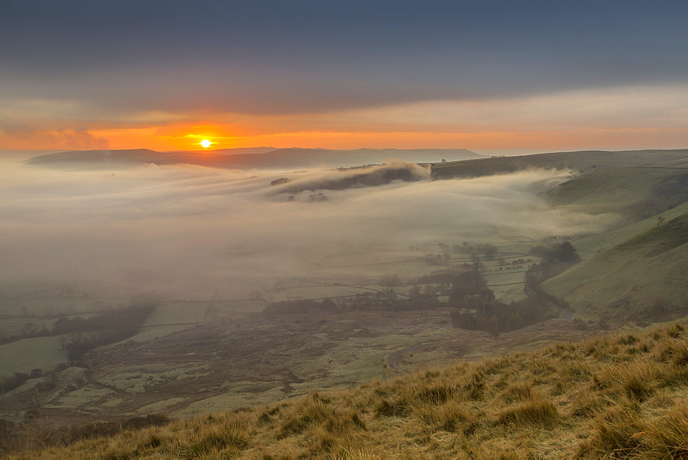 View from Mam Tor of fog in Hope Valley at sunrise, Castleton, Peak District National Park, Derbyshire, England, UK, Europe