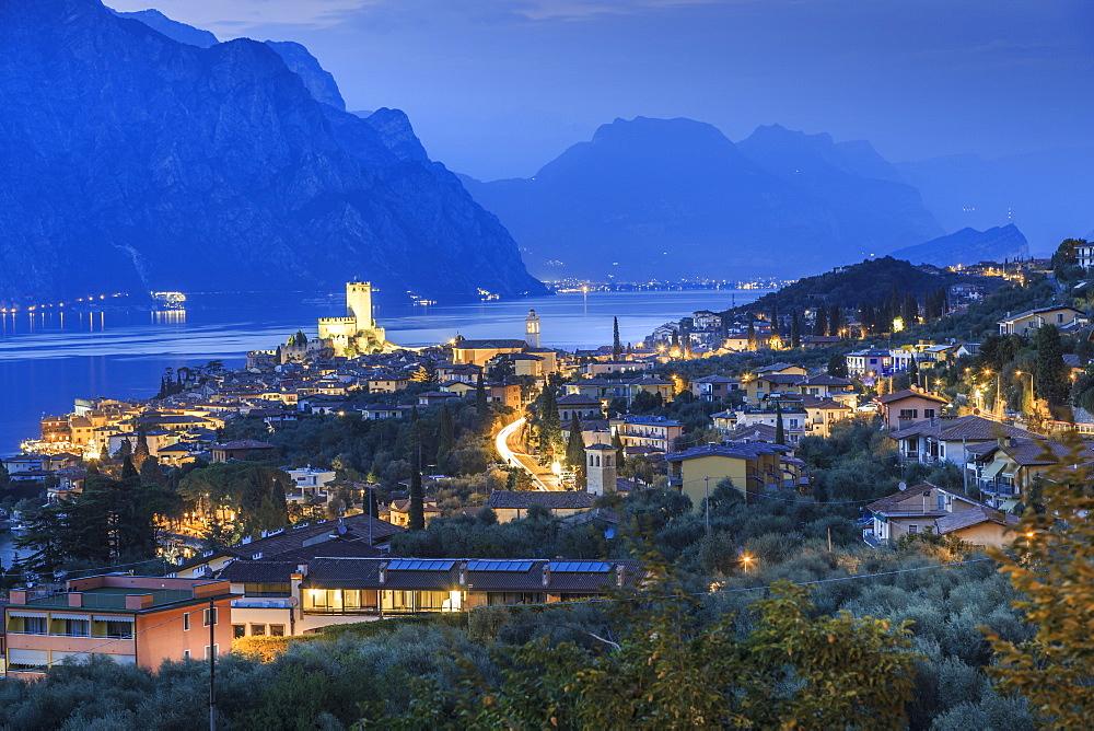 Elevated view of Castello Scaligero, Scaliger castle at dusk, Malcesine, Lake Garda, Veneto, Italy, Europe