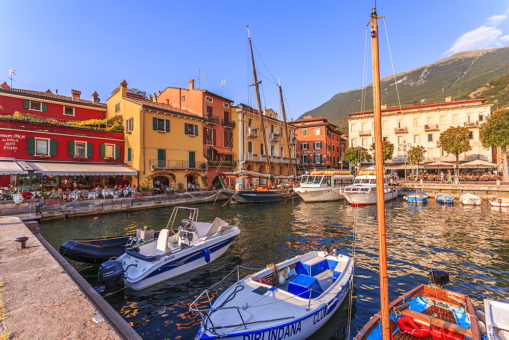 View of boats in Malcesine Harbour by the Lake, Malcesine, Lake Garda, Veneto, Italy, Europe